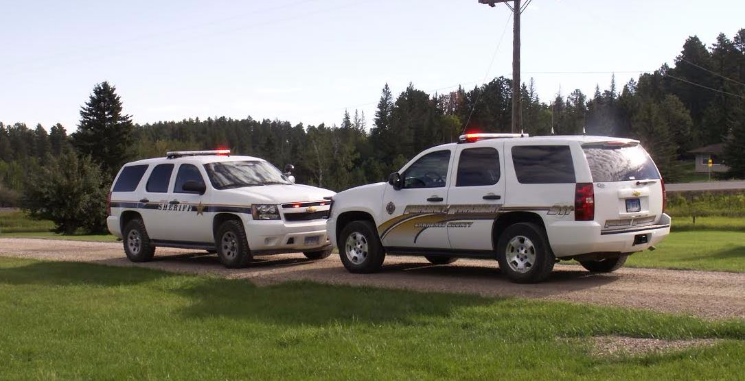 Two parked Sheriff vehicles