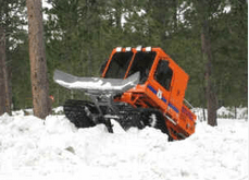 Weather watch and rescue move snow with snowcat